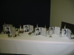 'In Memorial' table with portraits, obits and eternal candles for each of our classmates that have passed away. We wil