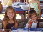 Kamry & Kinsey Snyder (2 of Kevin Snyder's daughters) smile for the camera and show off their face painting.