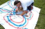 Sylvain Daly (Joann Fligor Daly's husband) and daughter decorate the KHS Class of '86 banner.